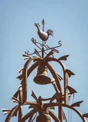 Cast-iron bell tower with an ornamental weathercock