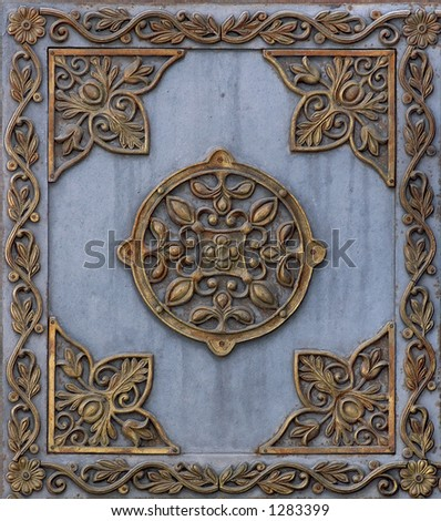 Cast iron metal plate with bronze pattern frame background