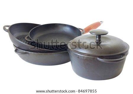 Cast iron pans and pot. Isolated on white background. Contains clipping path.