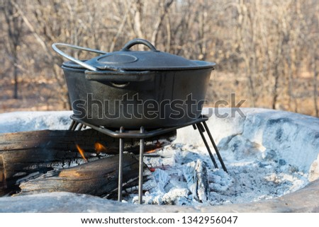 Cast-iron pot Potjie over the fire, cook stew at Onguma Campsite, Etosha, Namibia, Africa. #1342956047