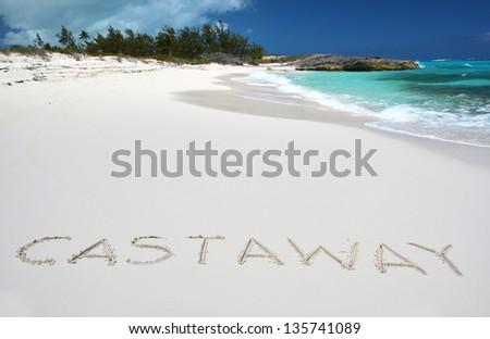 Castaway writing on a desrt beach of Little Exuma, Bahamas
