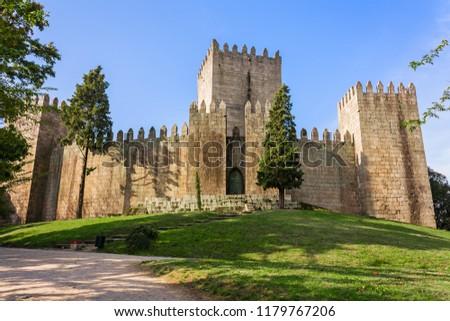 Castelo de Guimaraes Castle. Most famous castle in Portugal. Birth place of the first Portuguese King and the Portuguese nation. Guimaraes, Portugal. #1179767206
