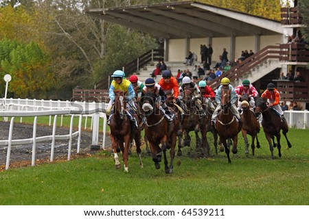 CASTERA VERDUZAN, FRANCE - OCTOBER 4: Racehorses round a bend during a race at the Baron hippodrome Castera Verduzan, France on October 4, 2010. Betting on horse racing is hugely popular in France.