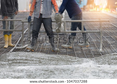 Casting Concrete slab work with worker by pump tube,Construction work. #1047037288