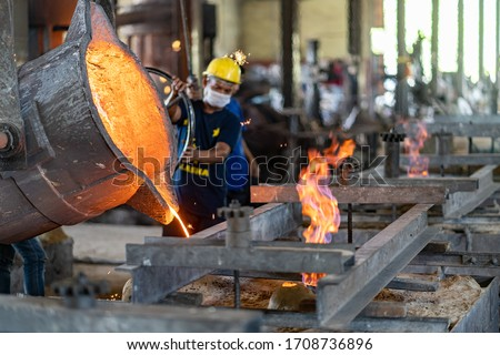 Casting  melting  molding and foundry. The most widely used non reusable mold method is sand casting a process in which specially treated sand is rammed around the pattern and placed in a support. Foto stock ©