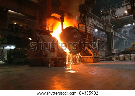 Casting of hot iron in foundry 2