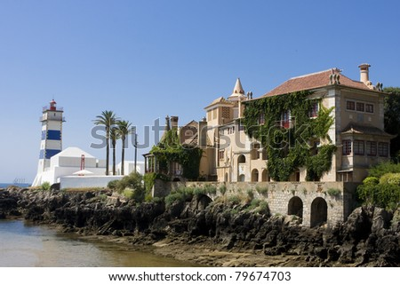 Castle and lighthouse near the sea in Cascais - Portugal - stock photo