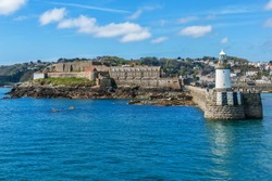 Castle Cornet has guarded Saint Peter Port for 800 years. Saint Peter Port - capital of Guernsey - British Crown dependency in English Channel off the coast of Normandy.