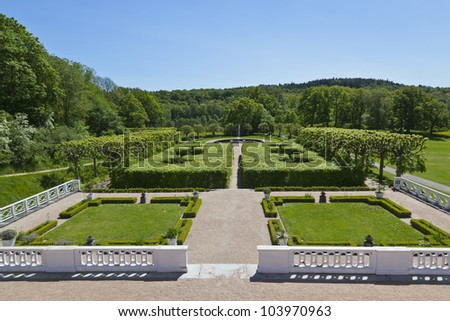 Castle garden with terrace and with trimmed trees and bushes