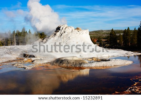 Castle Geyser (of the Upper Geyser Basin) reflecting in a pool - Yellowstone National Park.