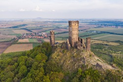 Castle Hazmburk. Ruines of Hazmburk castle on top of mountain peak of Ceske Stredohori range. Medieval castle with views on czech countryside landscape near village Klapy, Libochovice, Czech Republic.