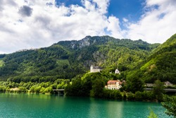 Castle Klaus on the blue lake in Austrian Alps. Summer day.