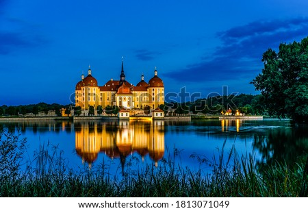 Castle manor on lake island in evening. Evening lake castle manor landmark. Castle manor lake water reflection