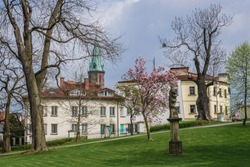 Castle park in Frydek-Mistek town, Moravian-Silesian Region of Czech Republic, view with tower of John the Baptist Church