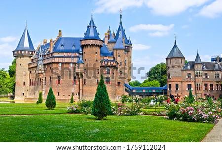 Castle park in summer landscape. Fable castle landmark. Castle in summer. Castle park view