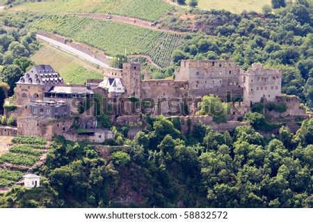 Castle Rheinfels in the Rhine Valley with surrounding vineyards, Germany