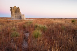 Castle Rock in Kansas is a dramatic 70-foot spire created by erosion of Smoky Hills chalk beds.