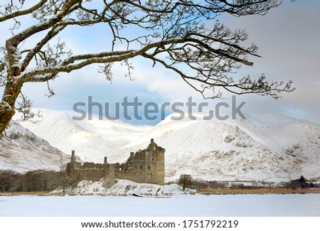 Castle ruins on Loch. Kilchurn castle on Loch Awe in winter in the Scottish Highlands Stock photo ©