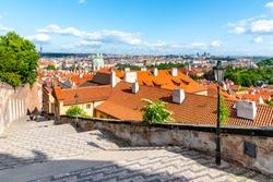 Castle Stairs of Prague Castle leads down to Lesser Town with Saint Nicholas church, Praha, Czech Republic.