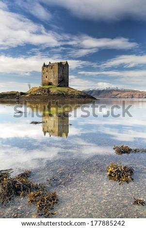 Castle Stalker reflecting on Loch Linnhe in the west coast of Scotland