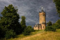 Castle tower against a dark sky