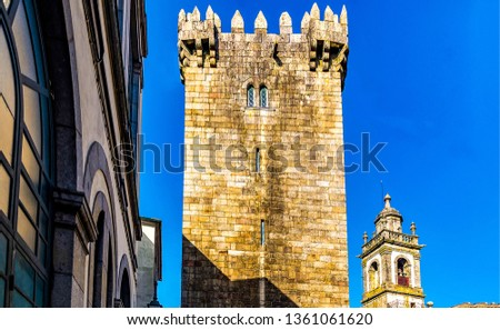 Castle tower on blue sky. Window in castle tower. Castle tower window view. Ancient castle tower windows #1361061620