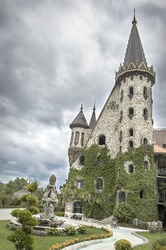Castle tower on the background of a stormy sky.