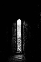 Castle window looking out into a field
