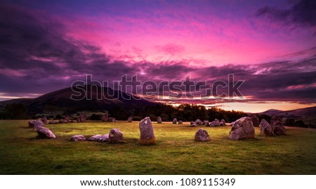 Castlerigg Stone Circle near Keswick, Cumbria, England. Bronze age stone circle taken just before sunrise, Blencathra mountain in the background.  #1089115349