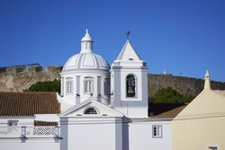 Castro Marim church view in Algarve, Portugal with the castle on the background