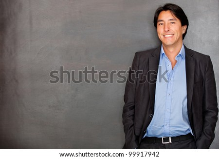Casual business man smiling and looking confident