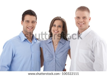 Casual business team portrait, young businesspeople standing hugging, smiling at camera. - stock photo