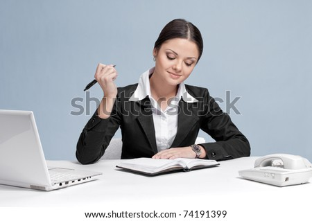 Casual business woman in office working with white table, laptop and diary personal organizer. Idea!