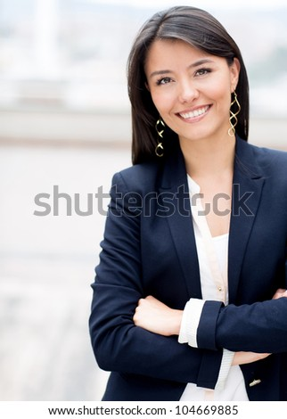 Casual business woman with arms crossed and smiling