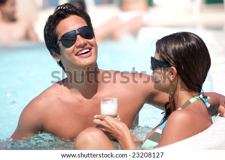 casual couple relaxing at the jacuzzi