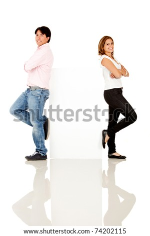 Casual couple with a banner - isolated over a white background