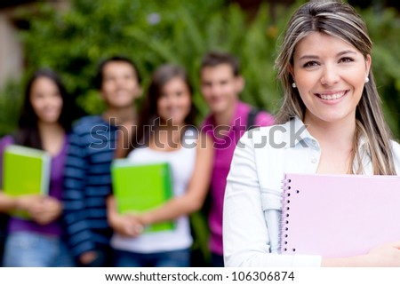 Casual female student at the university smiling