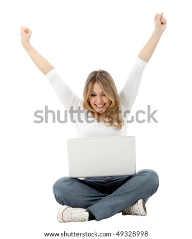 Casual girl full of success on a laptop isolated over a white background