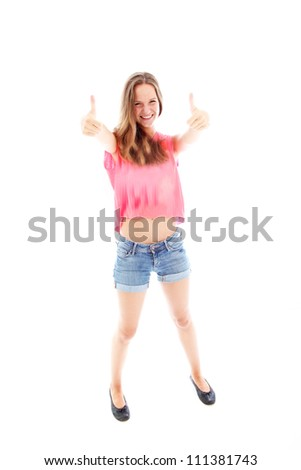 Casual girl giving a thumbs up Casual young girl with a lovely smile giving a double thumbs up of enthusiasm and motivation isolated on white
