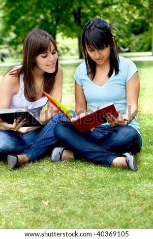 Casual girls portrait with notebooks studying outdoors