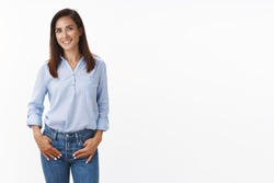 Casual good-looking adult 30s mother keep conversation child teacher, stand relaxed friendly smiling, hold hands loose jeans pockets, look camera amused, standing white background upbeat