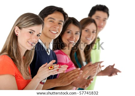 Casual group of people in a row applauding - isolated over a white background