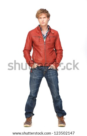 Casual guy standing with hands in jeans pocket. Isolated on white background