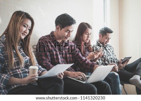 Casual home worker sitting in a row in team meeting