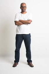casual indian male smiling full length with jeans