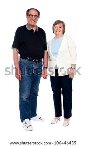 Casual love couple holding hands. Full length portrait