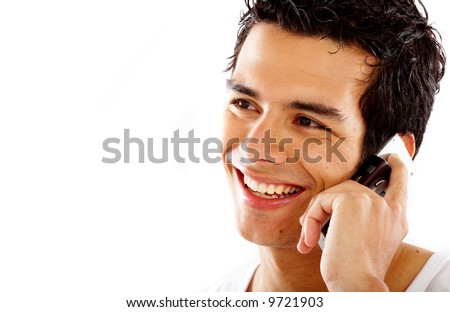 casual man smiling and talking on a mobile phone isolated over a white background