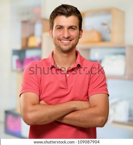Casual Man with Arms Crossed, indoor