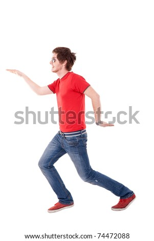 casual man with red t-shirt making a dance move, isolated