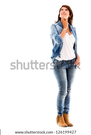Casual pensive woman - isolated over a white background - stock photo